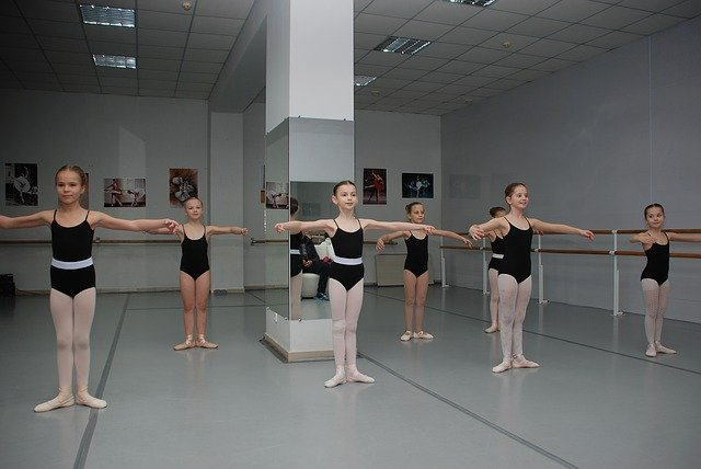 A group of people standing in a room